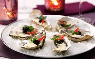 Warme oesters met Hollandaise-balsamicosaus